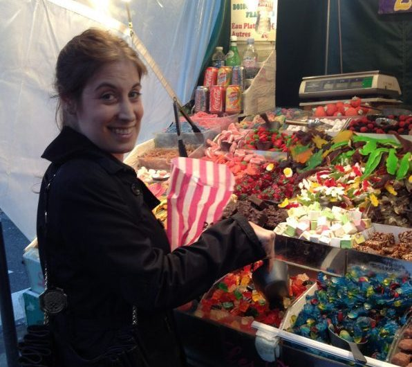 Girl at candy stand in Paris